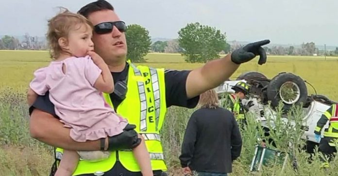 officer comforting 2-year-old