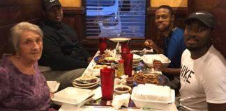 men eat with elderly woman